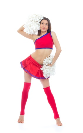 Beautiful cheerleader woman dancer girl from cheerleading team smiling isolated on a white background photo