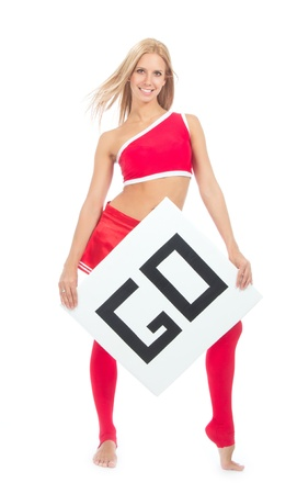 Cheerleader woman pointing her finger at a board or blank sign for your text sample go isolated on a white background Imagens - 17669726