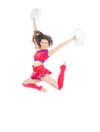 stunts: Happy female cheerleader dancer from cheerleading team jumping in mid air against white background