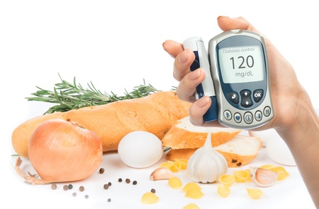 glucometer: Diabetes concept glucose meter in hand and healthy organic food