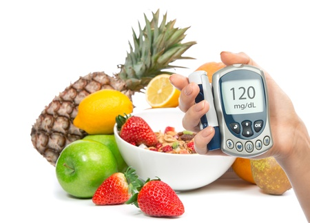diabetes: Diabetes concept glucose meter in hand and healthy organic food, lemon, pear, apples, fresh orange, pineapple and breakfast cereal muesli bowl on a white background