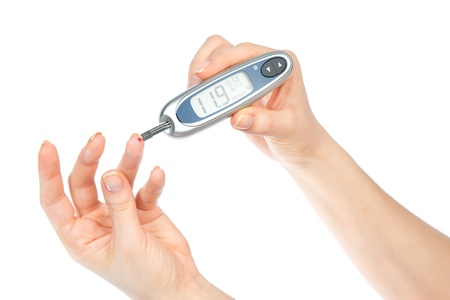 Diabetes composition glucometer in hand for measuring glucose level blood test isolated on a white background