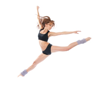 New pretty modern slim stylish teenage girl jumping dancing isolated on a white studio background photo