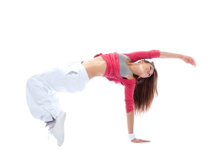 pretty modern slim hip-hop style teenage girl jumping dancing isolated on a white studio background photo