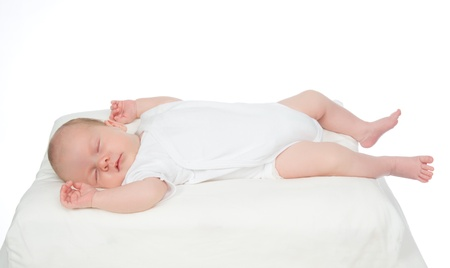 Newborn infant baby girl sleeping on her back on a white background Stock Photo
