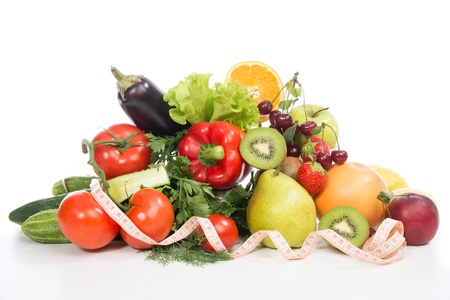 weight control: Diet weight loss breakfast concept with tape measure organic green apple, egg plant, orange, tomatoes, cucumbers, parsley, kiwi, grapefruit, salad, pearcherries on a white background Stock Photo