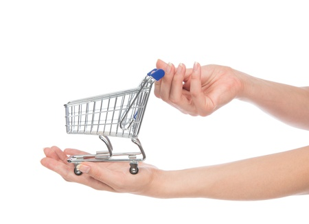 empty shopping cart: Hands hold empty shopping cart for sale isolated on a white background