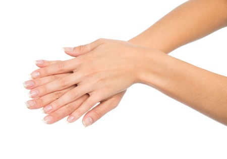 Beautiful woman hands with french manicure nails isolated on a white background Stock Photo
