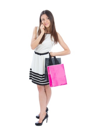 people walking white background: Full Body Happy Beautiful  woman with shopping bags cheerful smiling in contemporary casual dress on a white background Stock Photo