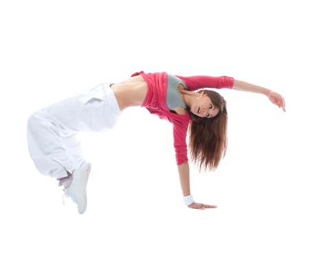 Young modern slim dancer girl exercise hip-hop style pose on the floor isolated on  white background photo
