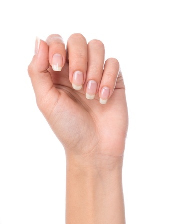 finger nails: Beautiful woman hand with french manicured nails isolated on a white background