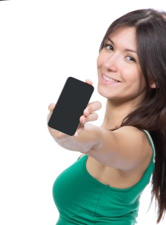 그녀의 새로운 터치 모바일 휴대 전화의 디스플레이보기 젊은 예쁜 여자. 손 전화에 초점 스톡 콘텐츠