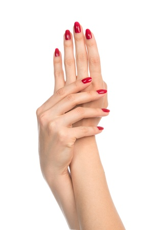 Woman hands with red manicured nails isolated on a white background Stock Photo - 21974847
