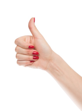 woman hand thumb up with manucure red nails isolated on white background photo