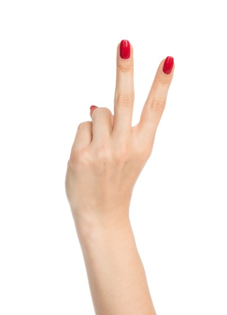 Hand with two fingers up in the peace or victory symbol the sign for V letter in sign language isolated on white background Stock Photo