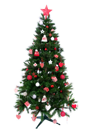 Christmas tree with Decorated ornament red star, patchwork hearts, hat and small presents new year 2014 style isolated on white background Stock Photo - 22663120