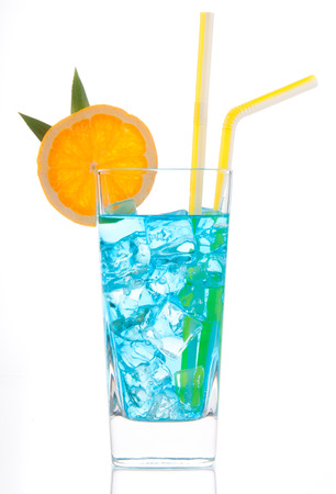 blue hawaiian drink: Summer margarita cocktail drink or blue hawaiian with lime with orange and straw isolated on a white background Stock Photo