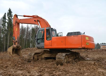 Big excavator Dredge on construction site photo