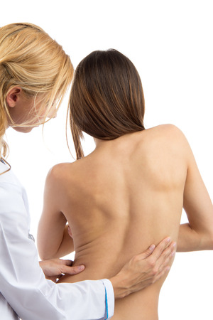 back ache: Doctor research patient spine scoliosis deformity backache isolated on a white background Stock Photo
