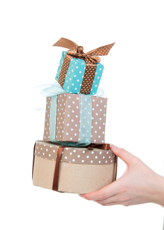 Hand with gift boxes in woman hand for christmas or birthday present on white background Stock Photo