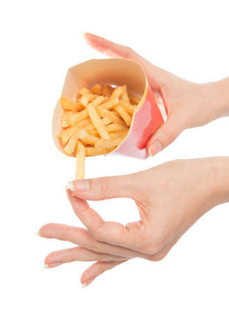 Hand take French fries chips meal on white background. Healthy weight loss diet concept. photo