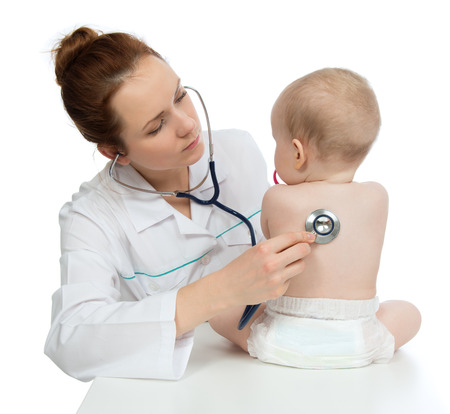 Doctor or nurse auscultating child baby patient spine with stethoscope physical therapy closeup composition on a white  photo