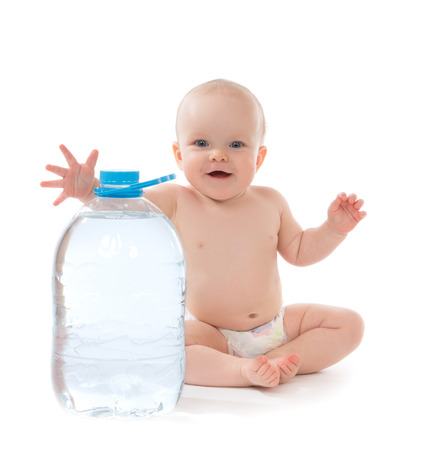 hand water: Infant child baby girl sitting with big bottle of drinking water in diaper and give five open hand sign smiling on white  Stock Photo