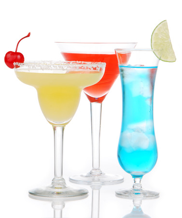 blue hawaiian drink: Popular alcoholic cocktails composition. Three cocktail drinks yellow margarita cherry blue curacao and tropical Martini on a white background