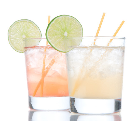 Summer beach margarita cocktails drink in spirit glasses isolated on a white background photo
