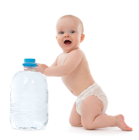 Infant child baby girl sitting with big bottle of drinking water in diaper and give five open hand sign smiling on white background photo