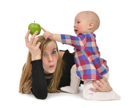 Happy  family mother and child baby boy kid with healthy green apple isolated on a white background photo
