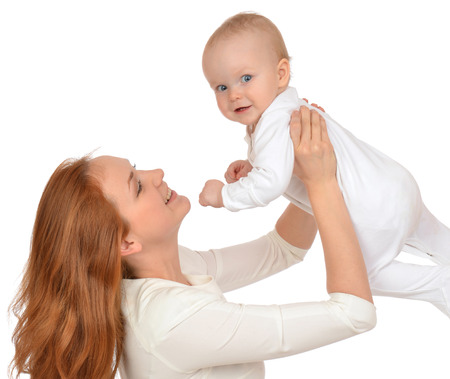 Young mother woman holding in her arms child baby kid girl in diaper on a white background photo