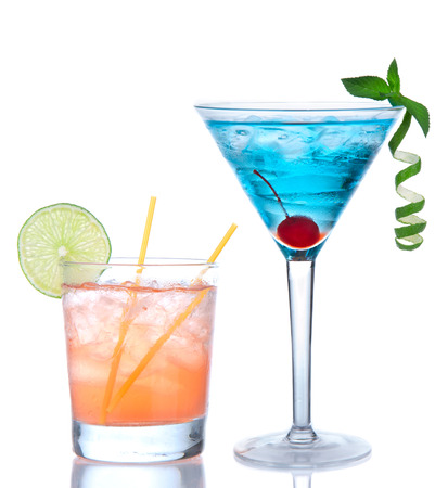 Tropical Martini cosmopolitan cocktail blue hawaiian and yellow margarita alcohol drink isolated on a white background photo
