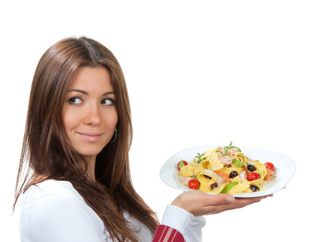 Waitress, chef holding plate with italian lemon pappardelle, tagliatelle, macaroni, spaghetti pasta with tomato, shrimps and olives on serviette, table napkin in other on a white background photo
