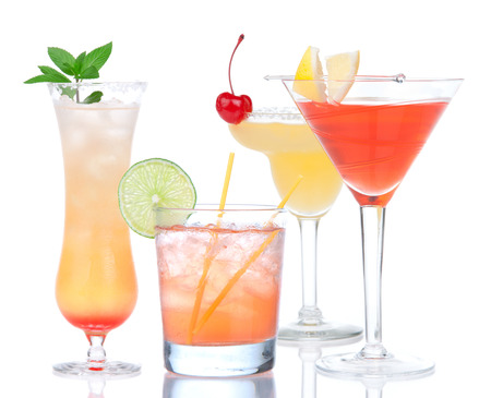 Popular alcoholic cocktails composition. Fourcocktail drinks yellow margarita cherry and tropical Martini on a white background photo
