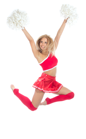 Cheerleader dancer from cheerleading team jumping in mid air and dancing isolated on a white background photo