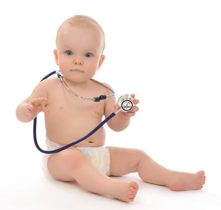 Infant child baby toddler sitting with medical stethoscope for physical therapy on a white background photo