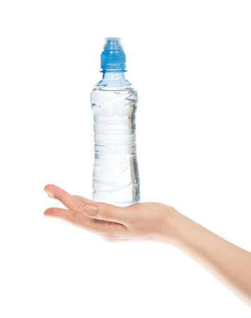 Hand hold bottle of drinking water on a white background photo