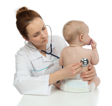 Doctor or nurse auscultating child baby patient heart with stethoscope physical therapy closeup composition on a white background photo