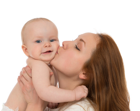baby diaper: Young mother woman holding and kissing in her arms infant child baby kid girl toddler in diaper on a white background