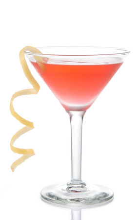 Cosmopolitan martini cocktail with vodka red cranberry juice lime and lemon spiral isolated on a white background 写真素材
