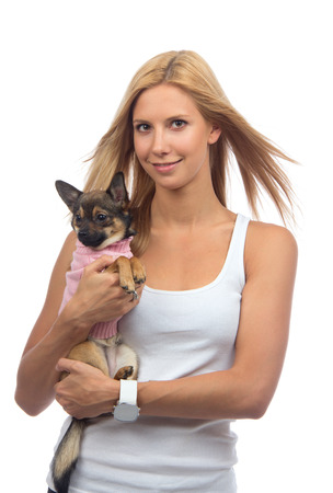 Young happy woman hold in hands small Chihuahua dog or puppy isolated on a white background photo