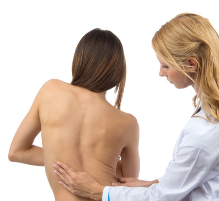 woman back pain: Doctor research patient spine scoliosis deformity backache isolated on a white background Stock Photo