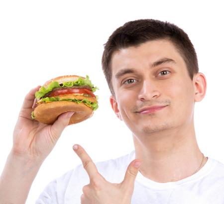 get ready: Uomo felice con panino hamburger malsano in mano pronti a mangiare isolato su uno sfondo bianco. Fast food concept