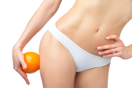 Hip legs abdomen and orange in hand cellulite liposuction woman weight loss control concept isolated against white  Stock Photo