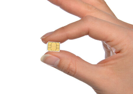 Hand hold micro nano SIM card isolated on a white background photo