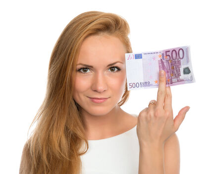 five dollars: Happy young woman holding up cash money five hundred euro in one note in hand smiling and looking at the camera isolated on a white background