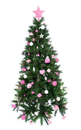 Decorated Christmas tree with patchwork ornament pink star hat balls and small presents for new year isolated on white background photo