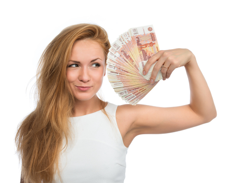 five dollars: Happy young woman holding up many cash money five thousand russian rubles notes in hand looking at the camera isolated on a white background