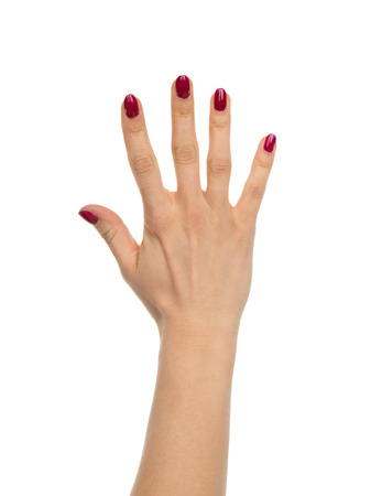Red manicured female open hand gesture number five fingers up isolated on a white background Stock Photo